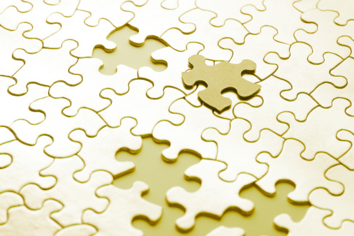 Close up of puzzle with missing pieces