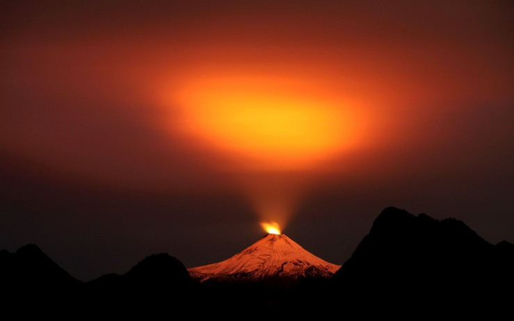 The Villarrica Volcano is seen at night in Pucon town
