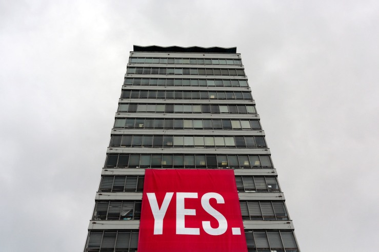 A large banner supporting a Yes vote hangs from a building in the Quays area of Dublin