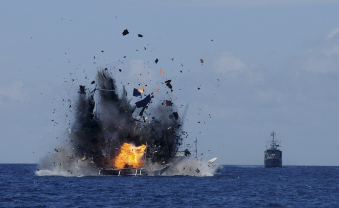 The Indonesian navy scuttles foreign fishing vessels caught fishing illegally in Indonesian waters near Bitung, North Sulawesi