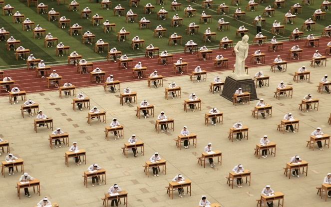Hundreds of students of the school of nursing take part in an open-air examination at a playground of an vocational college in Baoji