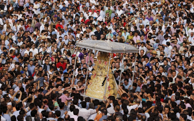 Pilgrims crowd around the Virgin of El Rocio during a procession around the shrine of El Rocio in Almonte, southern Spain