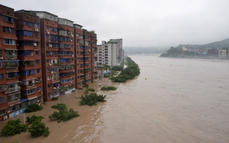 Residential buildings are seen partially submerged by an overflowing river after heavy rainfall hit Dazhou