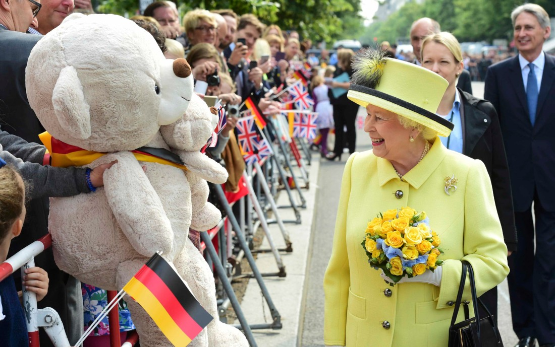 Britain's Queen Elizabeth greets members of public as she walks across the Pariser Platz near Brandenburg Gate in Berlin