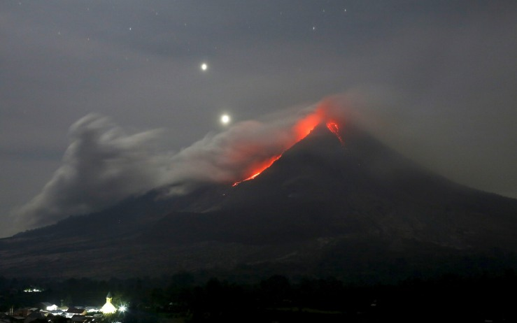 Mount Sinabung volcano spews hot lava as seen from Jeraya Village in Karo Regency