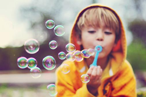 Boy blowing bubbles