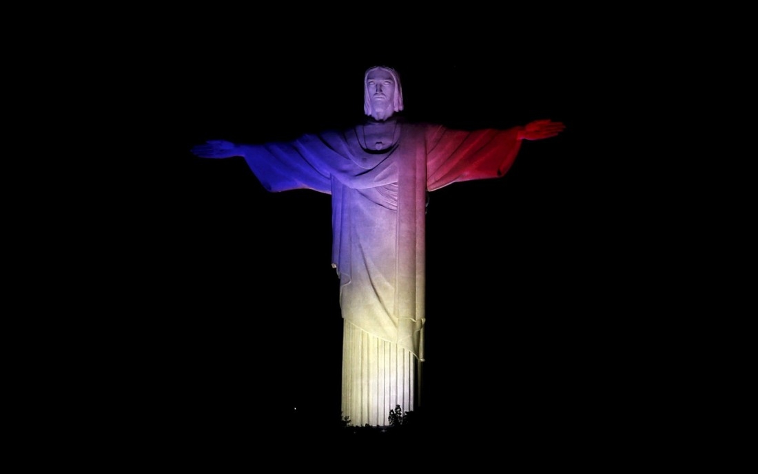 The statue of Christ the Redeemer is lit up in France's official colours, blue, white and red, to celebrate the traditional Bastille Day and as a sign of friendship to French Olympic athletes taking part in the 2016 Olympics, in Rio de Janeiro