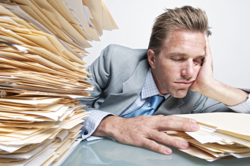Office Worker Falls Asleep Under Pile of File Folders